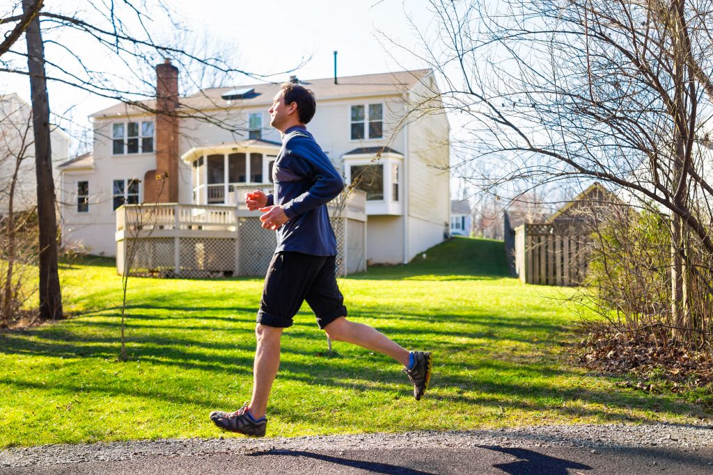 Young,Man,Running,Jogging,In,Motion,On,Trail,In,Residential